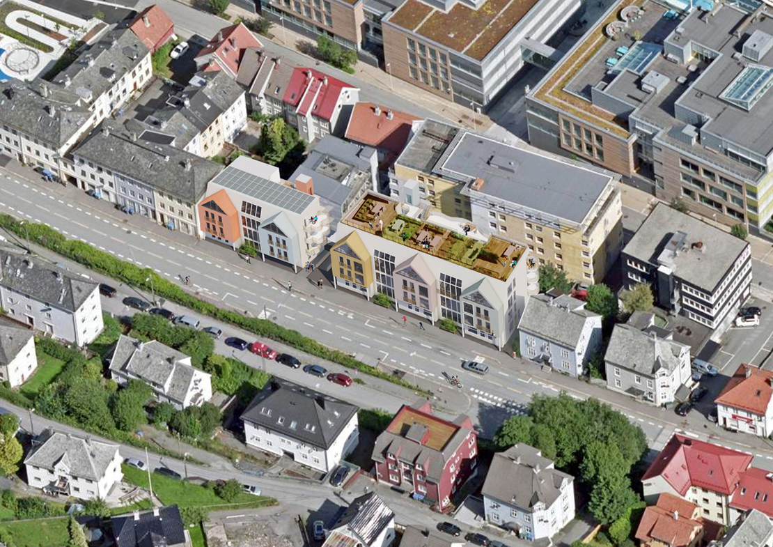 To bygårder og parkeringsplass gir plass til 32 leiligheter